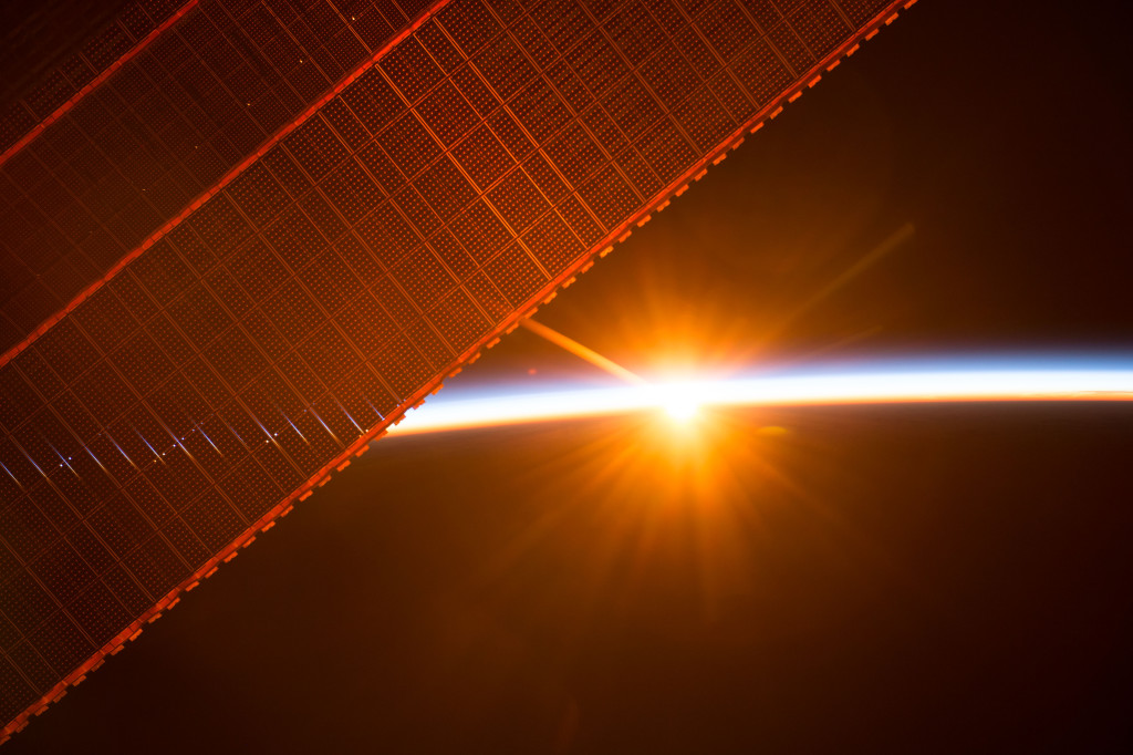 Fig. 1. Sunrise through the solar arrays, International Space Station [9]